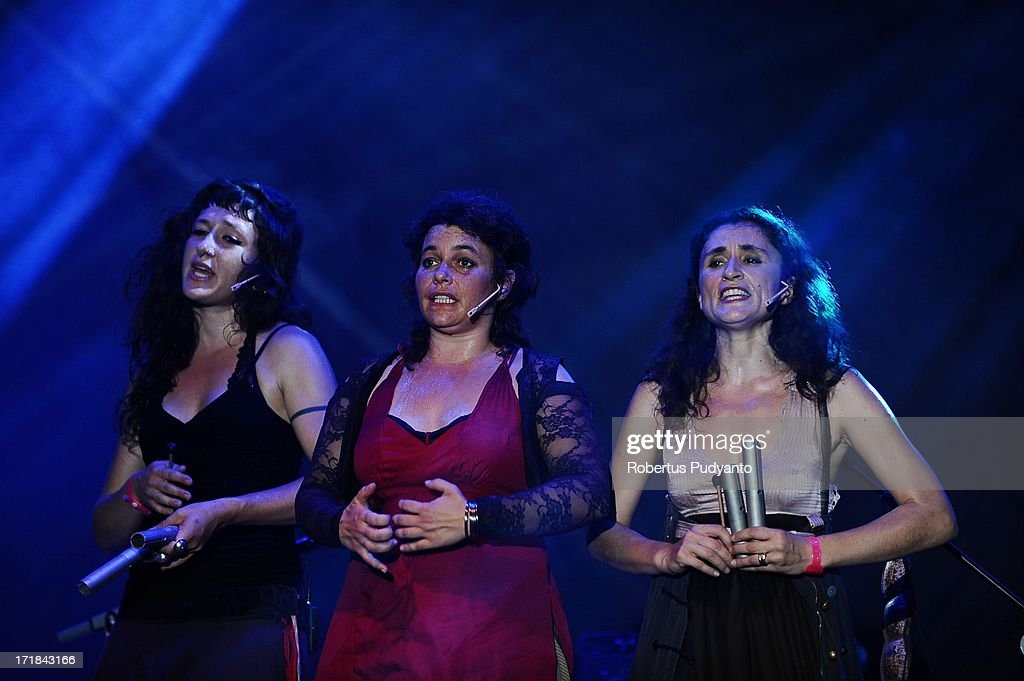Beatriz Salmeron-Martin (L), Anne Roy (C), and Lilia Ruocco (R) of Chet Nuneta (France) singing featuring a dazzling sound and theatrical display of vocal polyphonies and polyrhythms. They sing transcontinental traditional songs accompanied by mostly percussion in Rainforest World Music Festival at Sarawak Cultural Village on June 28, 2013 in Kuching, Sarawak, Malaysia.