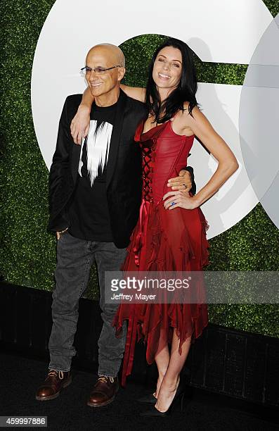Beats cofounder Jimmy Iovine and model Liberty Ross arrive at the 2014 GQ Men Of The Year Party at Chateau Marmont on December 4 2014 in Los Angeles...