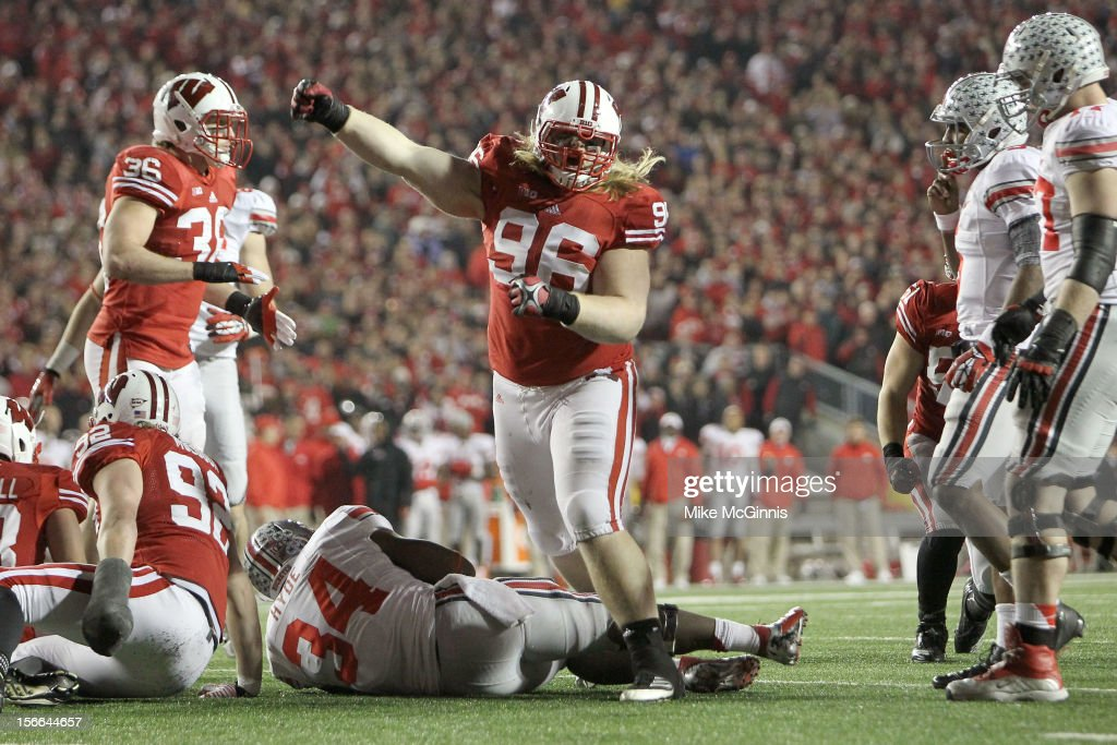 Beau Allen #96 of the Wisconsin Badgers celebrates after stopping Carlos Hyde #34 of the Ohio State Buckeyes short of the line of scrimmage during the game at Camp Randall Stadium on November 17, 2012 in Madison, Wisconsin.