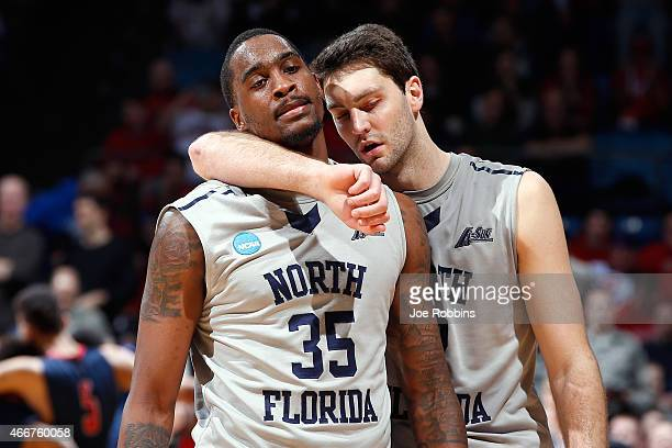 Beau Beech and Chris Davenport of the North Florida Ospreys walk off the court after losing to the Robert Morris Colonials 8177 during the first...