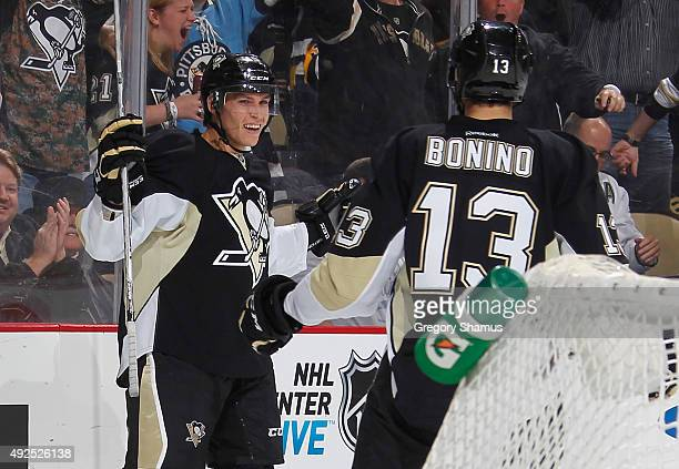Beau Bennett celebrates his goal with Nick Bonino of the Pittsburgh Penguins during the second period against the Montreal Canadiens at Consol Energy...