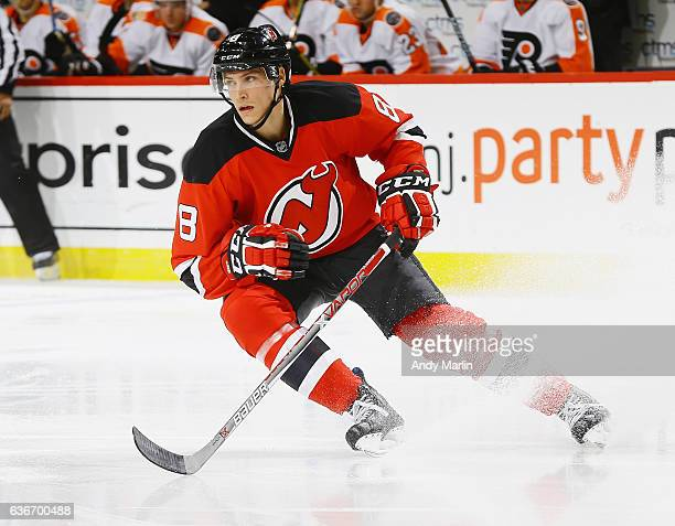 Beau Bennett of the New Jersey Devils skates during the game against the Philadelphia Flyers at the Prudential Center on December 22 2016 in Newark...