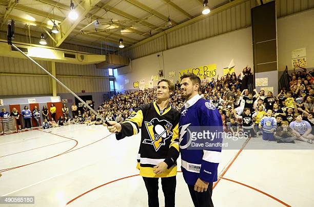 Beau Bennett of the Pittsburgh Penguins and Alex Killorn of the Tampa Bay Lightning take a selfie with the kids from Westmont Hilltop Middle School...