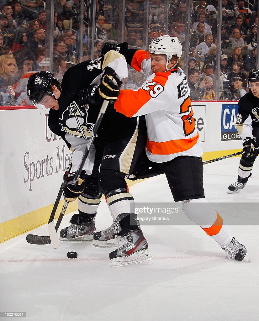 Beau Bennett #19 of the Pittsburgh Penguins battles for the loose puck against Erik Gustafsson #29 of the Philadelphia Flyers on February 20, 2013 at Consol Energy Center in Pittsburgh, Pennsylvania.