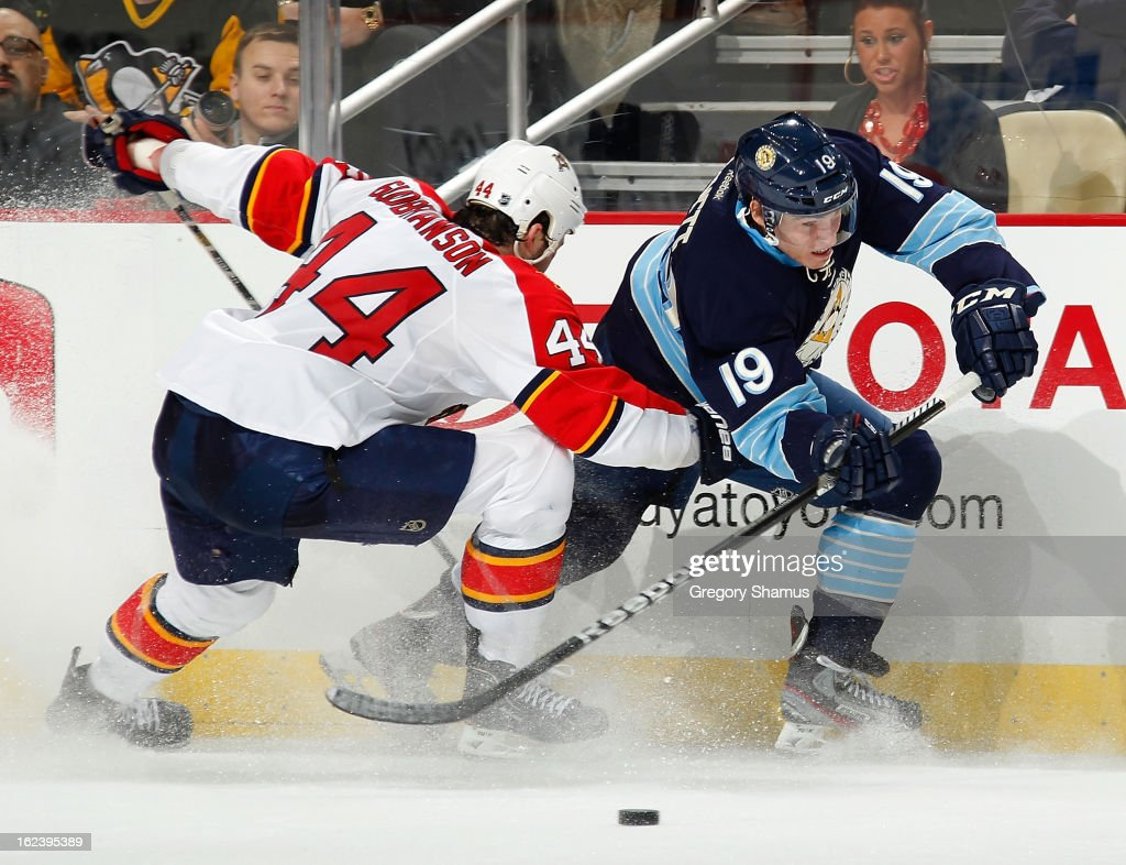 Beau Bennett #19 of the Pittsburgh Penguins battles for the puck against Erik Gudbranson #44 of the Florida Panthers on February 22, 2013 at Consol Energy Center in Pittsburgh, Pennsylvania.