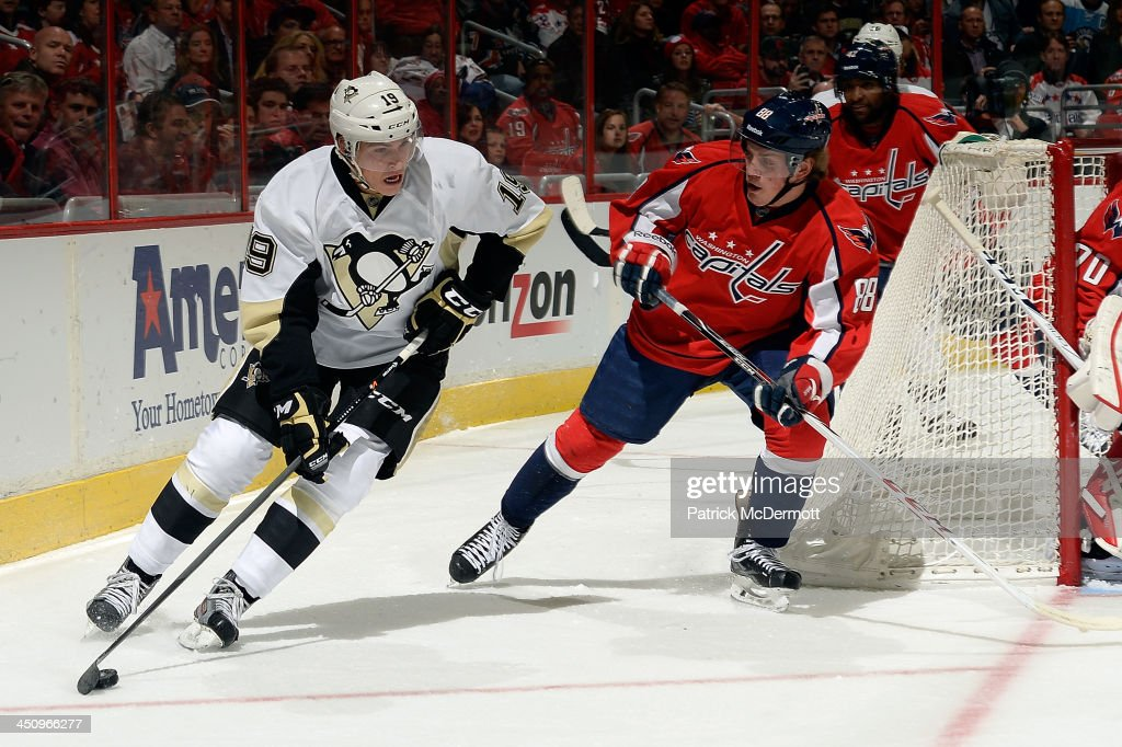<a gi-track='captionPersonalityLinkClicked' href=/galleries/search?phrase=Beau+Bennett&family=editorial&specificpeople=7029341 ng-click='$event.stopPropagation()'>Beau Bennett</a> #19 of the Pittsburgh Penguins brings the puck around the net against <a gi-track='captionPersonalityLinkClicked' href=/galleries/search?phrase=Nate+Schmidt&family=editorial&specificpeople=8280743 ng-click='$event.stopPropagation()'>Nate Schmidt</a> #88 of the Washington Capitals in the first period of an NHL game at Verizon Center on November 20, 2013 in Washington, DC.