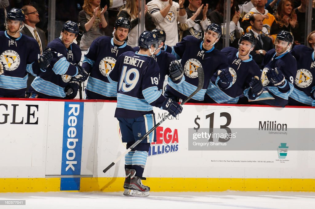 <a gi-track='captionPersonalityLinkClicked' href=/galleries/search?phrase=Beau+Bennett&family=editorial&specificpeople=7029341 ng-click='$event.stopPropagation()'>Beau Bennett</a> #19 of the Pittsburgh Penguins celebrates his first career NHL goal with the bench during the game against the Tampa Bay Lightning on February 24, 2013 at Consol Energy Center in Pittsburgh, Pennsylvania.