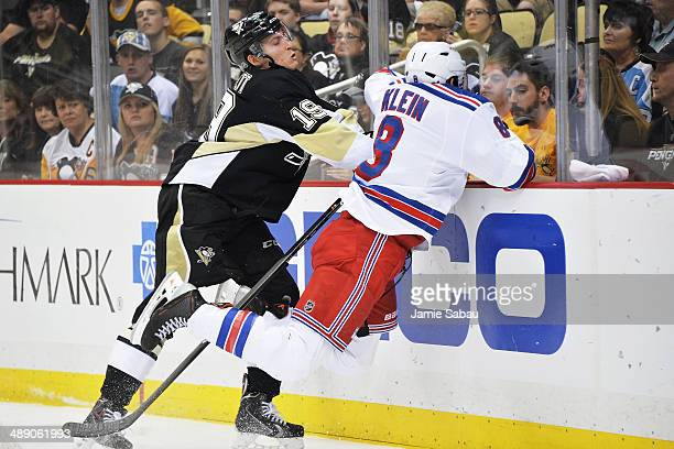 Beau Bennett of the Pittsburgh Penguins checks Kevin Klein of the New York Rangers in the second period in Game Five of the Second Round of the 2014...