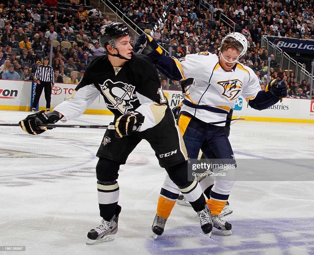 <a gi-track='captionPersonalityLinkClicked' href=/galleries/search?phrase=Beau+Bennett&family=editorial&specificpeople=7029341 ng-click='$event.stopPropagation()'>Beau Bennett</a> #19 of the Pittsburgh Penguins collides with <a gi-track='captionPersonalityLinkClicked' href=/galleries/search?phrase=David+Legwand&family=editorial&specificpeople=202553 ng-click='$event.stopPropagation()'>David Legwand</a> #11 of the Nashville Predators on November 15, 2013 at Consol Energy Center in Pittsburgh, Pennsylvania.