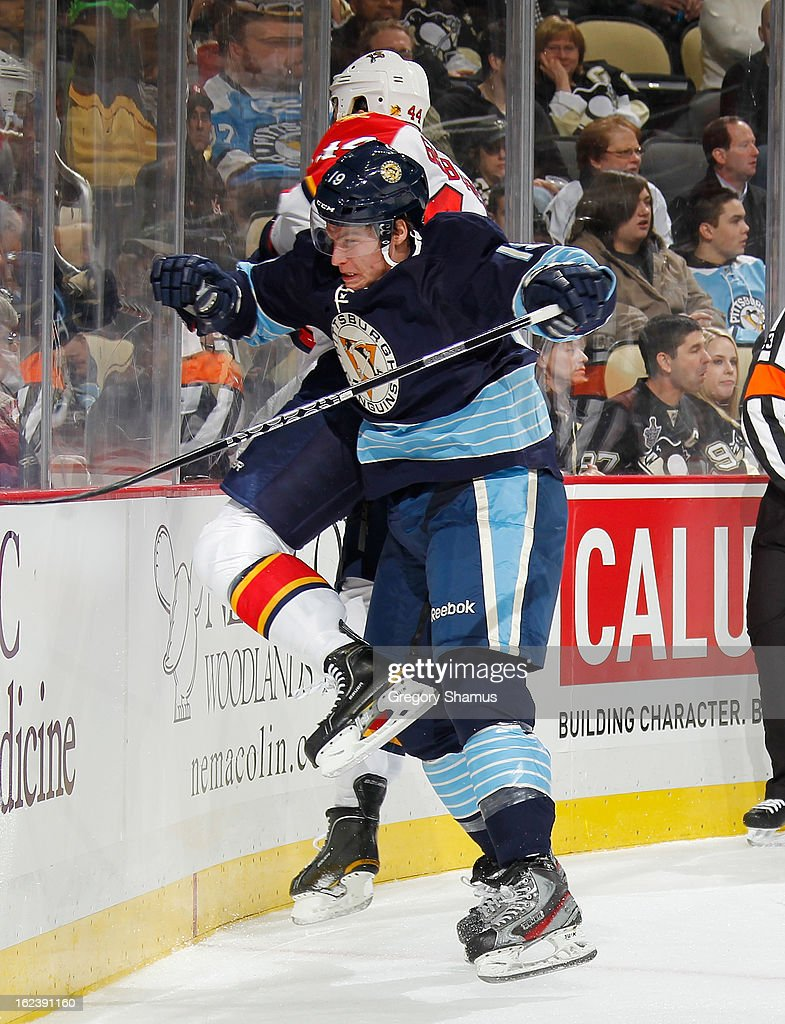 Beau Bennett #19 of the Pittsburgh Penguins collides with Erik Gudbranson #44 of the Florida Panthers on February 22, 2013 at Consol Energy Center in Pittsburgh, Pennsylvania.