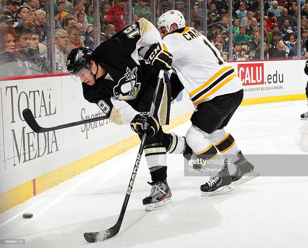 <a gi-track='captionPersonalityLinkClicked' href=/galleries/search?phrase=Beau+Bennett&family=editorial&specificpeople=7029341 ng-click='$event.stopPropagation()'>Beau Bennett</a> #19 of the Pittsburgh Penguins gets checked by <a gi-track='captionPersonalityLinkClicked' href=/galleries/search?phrase=Gregory+Campbell&family=editorial&specificpeople=640895 ng-click='$event.stopPropagation()'>Gregory Campbell</a> #11 of the Boston Bruins on March 17, 2013 at Consol Energy Center in Pittsburgh, Pennsylvania.