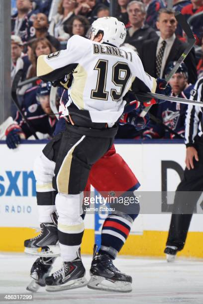 Beau Bennett of the Pittsburgh Penguins is knocked to the ice by Dalton Prout of the Columbus Blue Jackets during the third period in Game Four of...