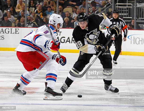 Beau Bennett of the Pittsburgh Penguins moves the puck in front of Kevin Klein of the New York Rangers in Game Five of the Second Round of the 2014...