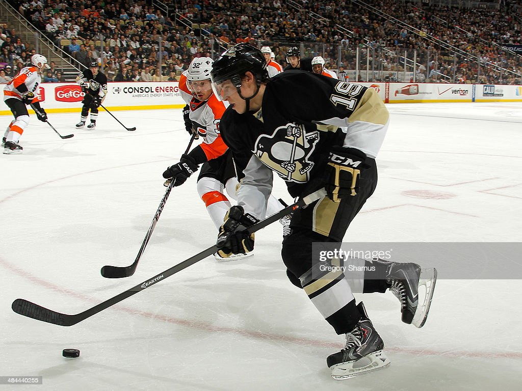 Beau Bennett #19 of the Pittsburgh Penguins moves the puck past Mark Streit #32 of the Philadelphia Flyers on April 12, 2014 at Consol Energy Center in Pittsburgh, Pennsylvania. Philadelphia won the game 4-3 in overtime.