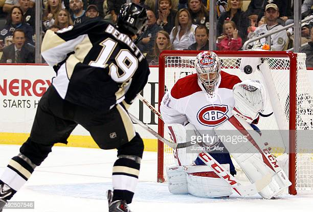 Beau Bennett of the Pittsburgh Penguins shoots the puck over Carey Price of the Montreal Canadiens during the game at Consol Energy Center on October...