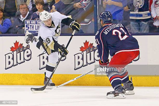 Beau Bennett of the Pittsburgh Penguins shoots the puck past James Wisniewski of the Columbus Blue Jackets during Game Six of the First Round of the...