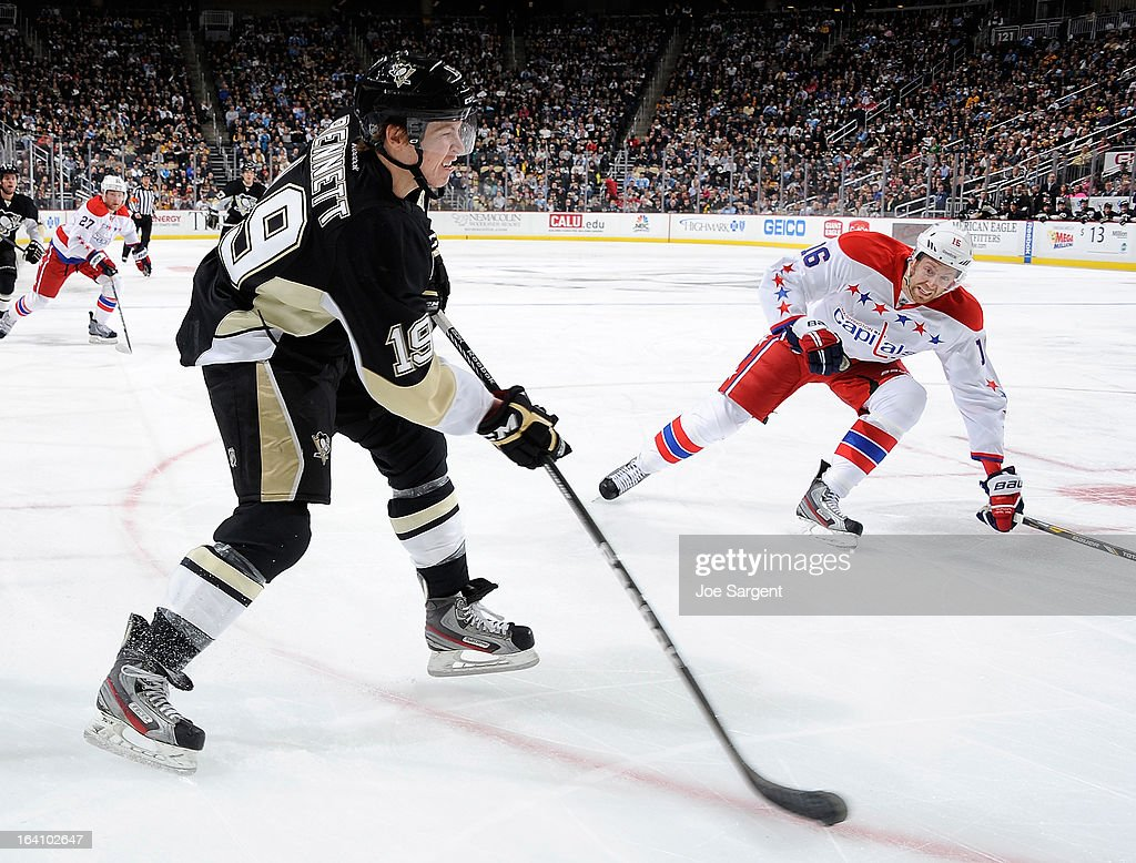 <a gi-track='captionPersonalityLinkClicked' href=/galleries/search?phrase=Beau+Bennett&family=editorial&specificpeople=7029341 ng-click='$event.stopPropagation()'>Beau Bennett</a> #19 of the Pittsburgh Penguins takes a shot in front of <a gi-track='captionPersonalityLinkClicked' href=/galleries/search?phrase=Eric+Fehr&family=editorial&specificpeople=566939 ng-click='$event.stopPropagation()'>Eric Fehr</a> #16 of the Washington Capitals on March 19, 2013 at Consol Energy Center in Pittsburgh, Pennsylvania. Pittsburgh won the game 2-1.