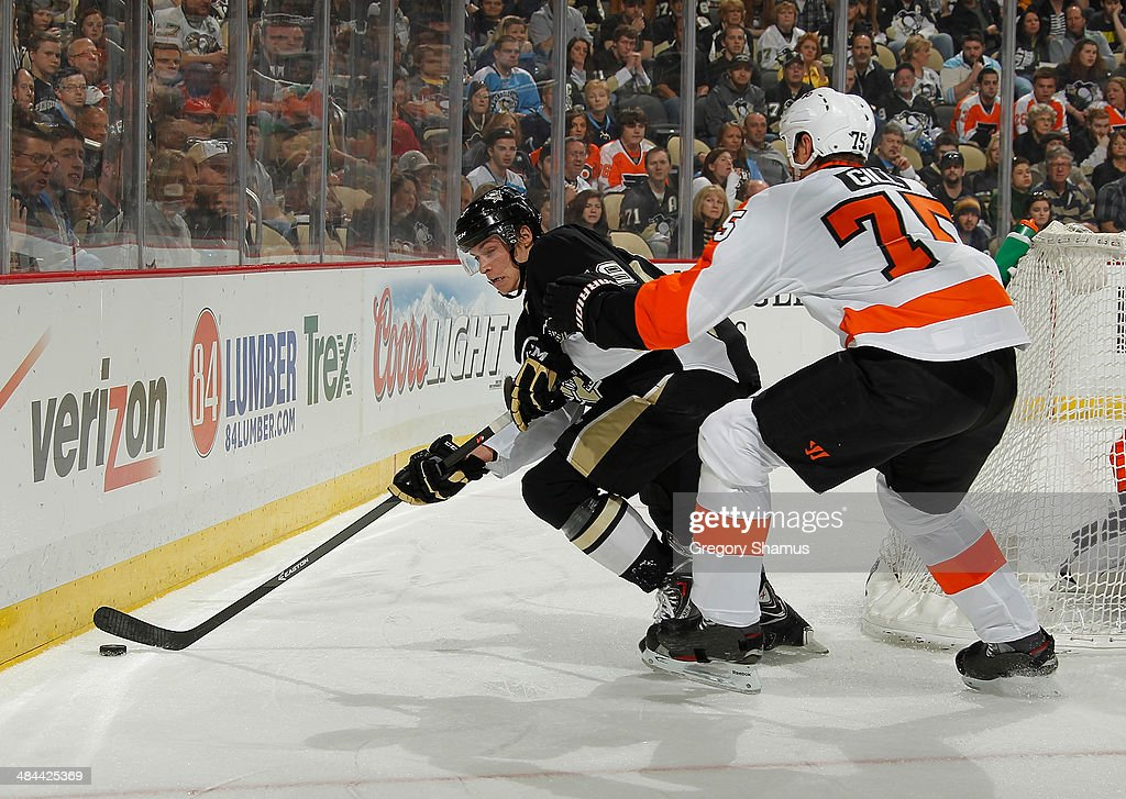 Beau Bennett #19 of the Pittsburgh Penguins tries to get past the defense of Hal Gill #75 of the Philadelphia Flyers on April 12, 2014 at Consol Energy Center in Pittsburgh, Pennsylvania.