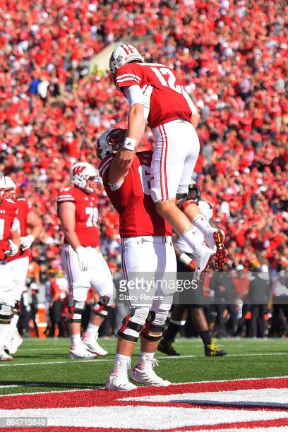 Beau Benzschawel of the Wisconsin Badgers celebrates a touchdown with Alex Hornibrook during a game against the Maryland Terrapins at Camp Randall...