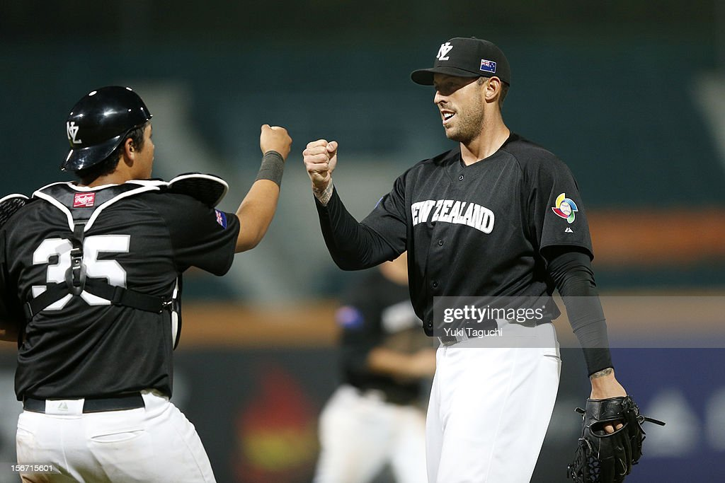 Beau Bishop #35 and Lincoln Holdzkom #17 of Team New Zealand celebrate defeating Team Philippines in Game 5 of the 2013 World Baseball Classic Qualifier between Team New Zealand and Team Philippines at Xinzhuang Stadium in New Taipei City, Taiwan on Saturday, November 17, 2012.