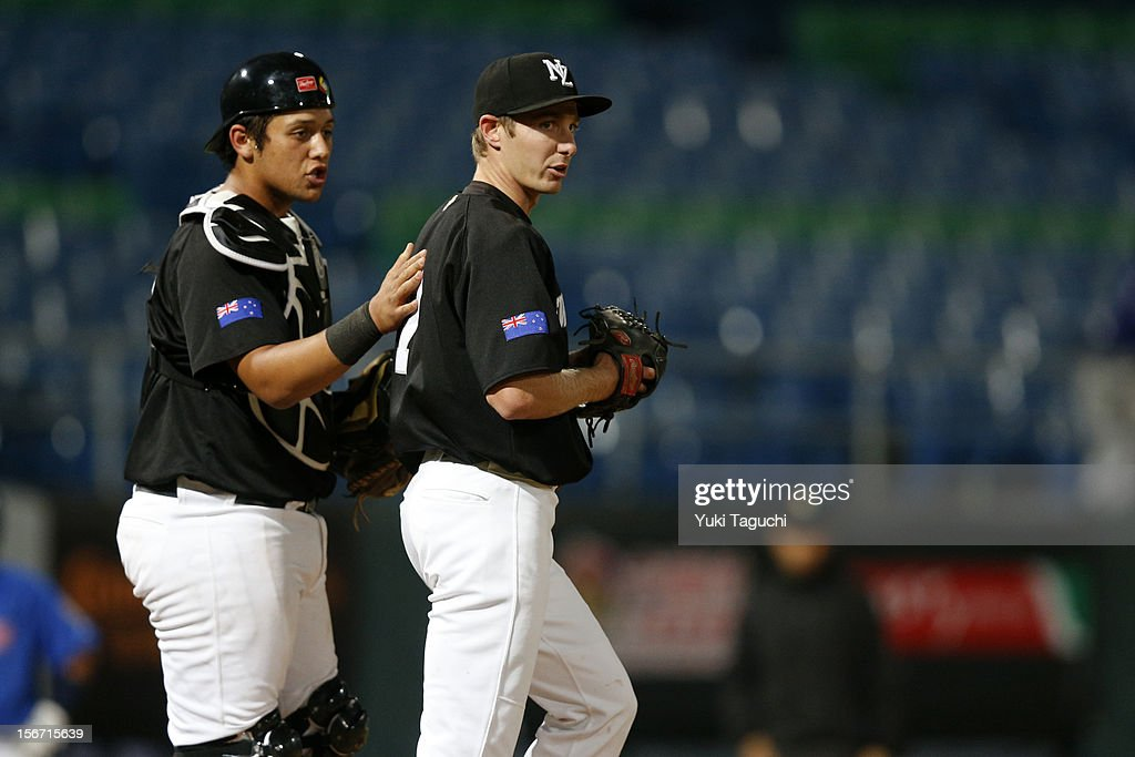 Beau Bishop #35 and Nick Dawson #7 of Team New Zealand meet on the mound during Game 5 of the 2013 World Baseball Classic Qualifier against Team Philippines at Xinzhuang Stadium in New Taipei City, Taiwan on Saturday, November 17, 2012.