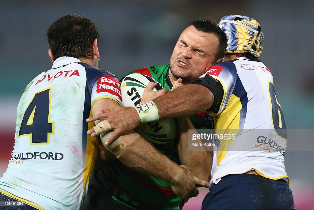 Beau Champion of the Rabbitohs is tackled during the round nine NRL match between the South Sydney Rabbitohs and the North Queensland Cowboys at ANZ Stadium on May 10, 2013 in Sydney, Australia.