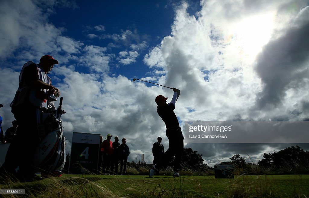 Beau Hossler of the United States Team plays his tee shot on the 4th hole in his match against Jack Hume of the Great Britain and Ireland Team during...