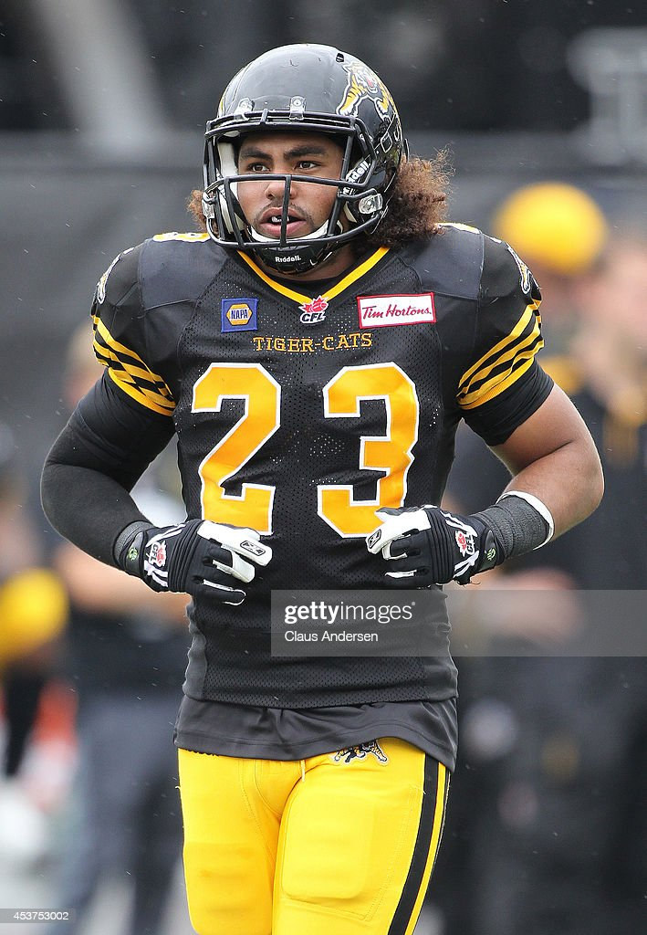 Beau Landry of the Hamilton TigerCats plays against the Calgary Stampeders in a CFL game at Ron Joyce Stadium on August 16 2014 in Hamilton Ontario...