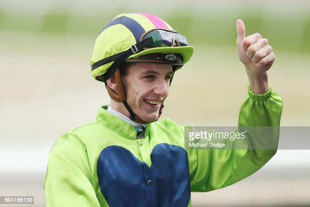 Beau Mertens celebrates after winning on Snitty Kitty in the Harrolds Caulfield Sprint during Melbourne Racing at Caulfield Racecourse on October 21...