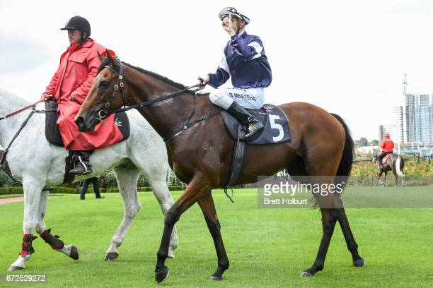 Beau Mertens returns to the mounting yard aboard Hans Holbein after winning the Flt Lt Peter Armytage Handicap at Flemington Racecourse on April 25...