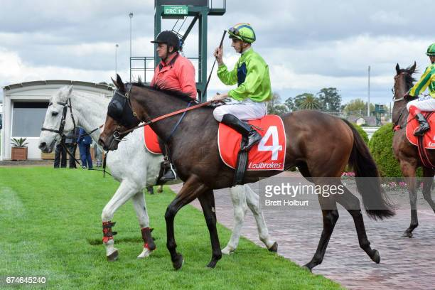 Beau Mertens returns to the mounting yard aboard Snitty Kitty after winning the Changing Places Real Estate Handicap at Caulfield Racecourse on April...