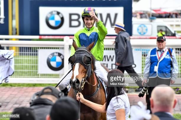 Beau Mertens returns to the mounting yard aboard Snitty Kitty after winning the Harrolds Caulfield Sprint at Caulfield Racecourse on October 21 2017...
