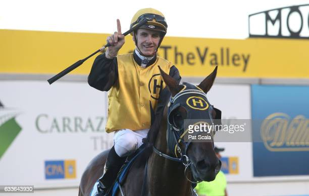 Beau Mertens returns to the mounting yard on Hard Call after winning Carrazzo Consulting Handicap at Moonee Valley Racecourse on February 03 2017 in...