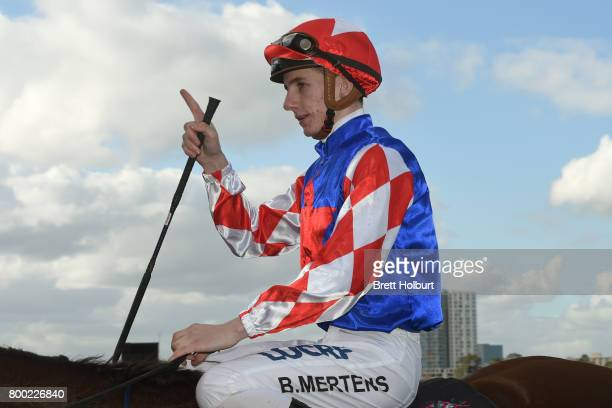 Beau Mertens returns to the mounting yard on Schism after winning Loddon Mallee Region Handicap at Flemington Racecourse on June 24 2017 in...
