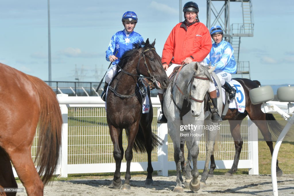 Beau Mertens returns to the mounting yard on Southern Bolt (NZ) after winning Racing.com SV 3YO Maiden Plate at Racing.com Park Synthetic Racecourse on August 22, 2017 in Pakenham, Australia.
