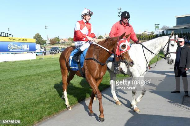 Beau Mertens returns to the mounting yard on Stylish Miss after winning the Kane Constructions Handicap at Moonee Valley Racecourse on June 17 2017...