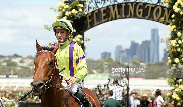 Beau Mertens returns to the mounting yard on Thermal Current after winning Arbroath Handicap at Flemington Racecourse on January 14 2017 in...