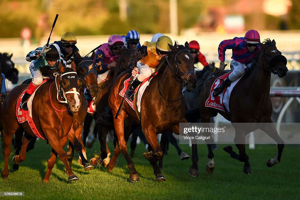Beau Mertens riding Hard Call (ctr) wins Race 9 during Melbourne Racing at Caulfield Racecourse on April 30, 2016 in Melbourne, Australia.