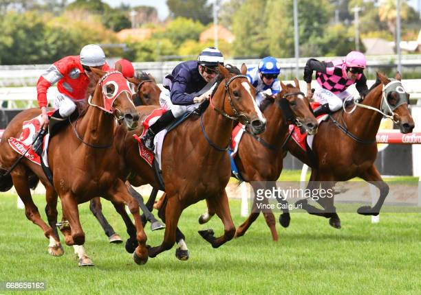 Beau Mertens riding Quilate defeats Ben Allen riding Ma Jones but loses race on protest in Race 1 during Melbourne Racing at Caulfield Racecourse on...