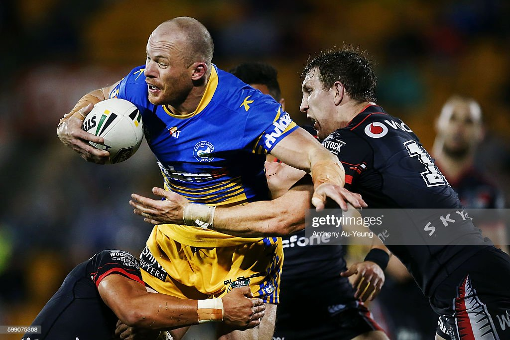 Beau Scott of the Eels charges against Ryan Hoffman of the Warriors during the round 26 NRL match between the New Zealand Warriors and the Parramatta Eels at Mt Smart Stadium on September 4, 2016 in Auckland, New Zealand.
