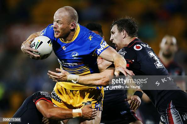 Beau Scott of the Eels charges against Ryan Hoffman of the Warriors during the round 26 NRL match between the New Zealand Warriors and the Parramatta...