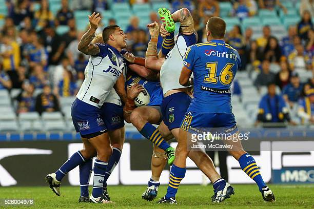 Beau Scott of the Eels is tackled during the round nine NRL match between the Parramatta Eels and the Canterbury Bulldogs at ANZ Stadium on April 29...