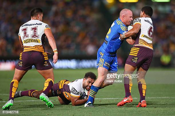 Beau Scott of the Eels is tackled during the round one NRL match between the Parramatta Eels and the Brisbane Broncos at Pirtek Stadium on March 3...