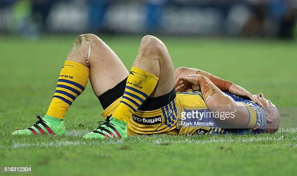 Beau Scott of the Eels lays down holding his shoulder after a tackle during the round three NRL match between the Canterbury Bulldogs and the...