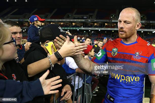 Beau Scott of the Knights greets fans after playing his last home game for the Knights during the round 25 NRL match between the Newcastle Knights...