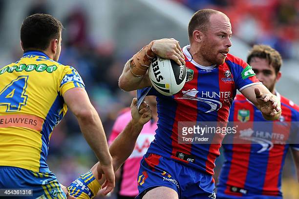 Beau Scott of the Knights runs the ball during the round 25 NRL match between the Newcastle Knights and the Parramatta Eels at Hunter Stadium on...