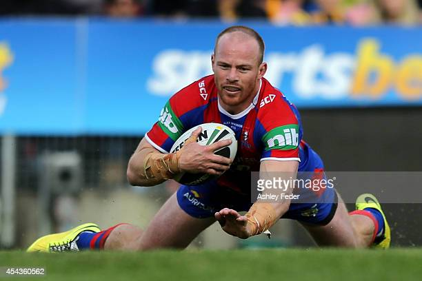 Beau Scott of the Knights scores a try during the round 25 NRL match between the Newcastle Knights and the Parramatta Eels at Hunter Stadium on...