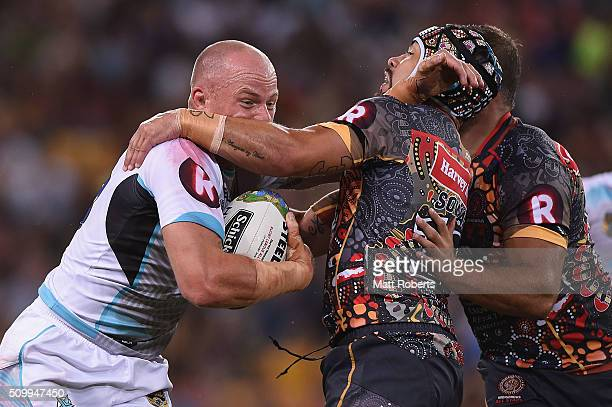 Beau Scott of the World All Stars is tackled by Jamie Soward of the Indigenous All Stars during the NRL match between the Indigenous AllStars and the...