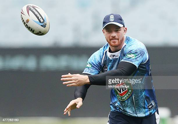 Beau Scott offloads the ball during a New South Wales Blues State of Origin training session at the Melbourne Cricket Ground on June 16 2015 in...