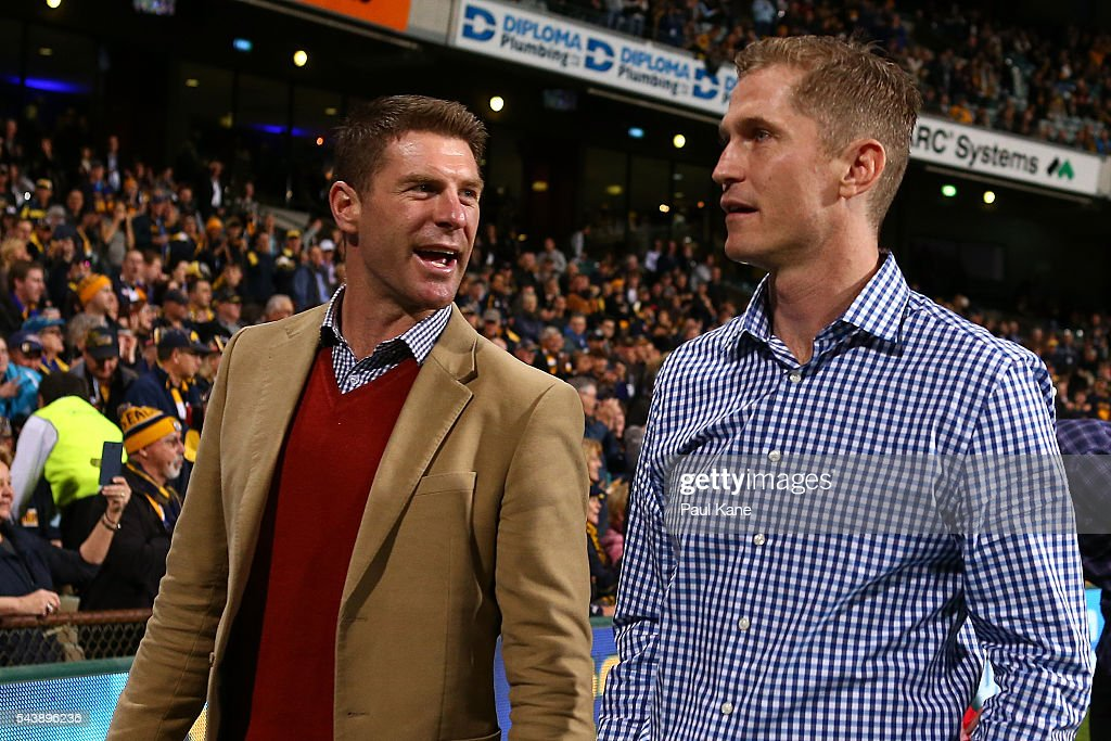 Beau Waters and <a gi-track='captionPersonalityLinkClicked' href=/galleries/search?phrase=Adam+Selwood&family=editorial&specificpeople=586995 ng-click='$event.stopPropagation()'>Adam Selwood</a> walk a lap of honour with team mates celebrating the West Coast Eagles 2006 Premiership anniversary during the round 15 AFL match between the West Coast Eagles and the Essendon Bombers at Domain Stadium on June 30, 2016 in Perth, Australia.